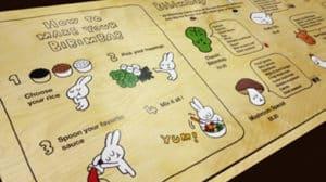 A menu made up of contour cut stickers onto wood