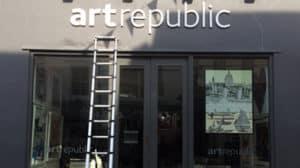 White perspex laser cut shop sign