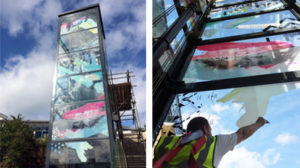 A glass lift with printed vinyl abstract artwork on the glass