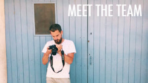 meet the team zoli looking at camera white t shirt blue beach hut
