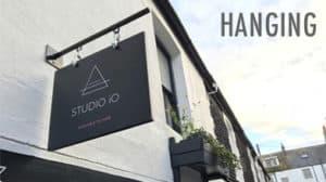 studio 10 hanging signage custom exterior building