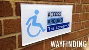 Wayfinding perspex signage access around the corner