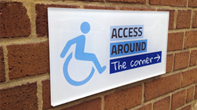 access around the corner wheelchair raised perspex signage custom